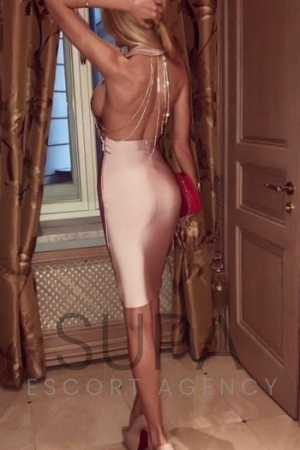 Beatrice showing off her perfect ass in tight pink dress