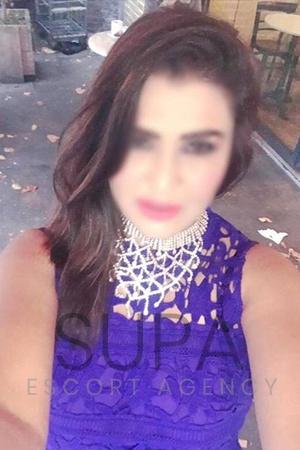 Aesha in blue dress
