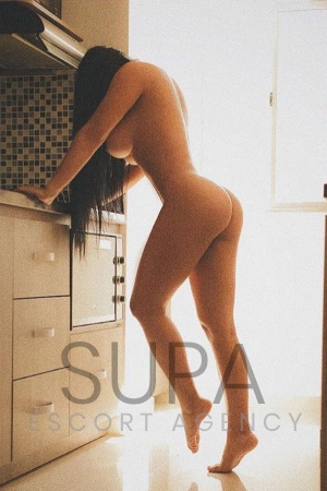 Ivana posing naked in kitchen